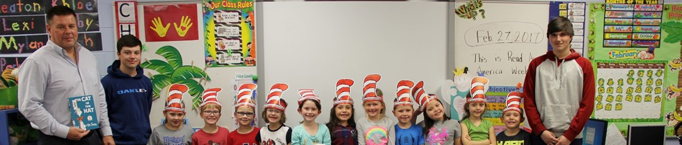 Sterling School Principal Mike Whitaker and students read to kindergartners during Read Across America Week.